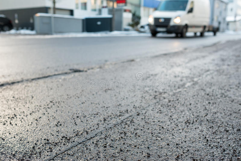 Grit in winter on a sidewalk. Beside a road royalty free stock photos
