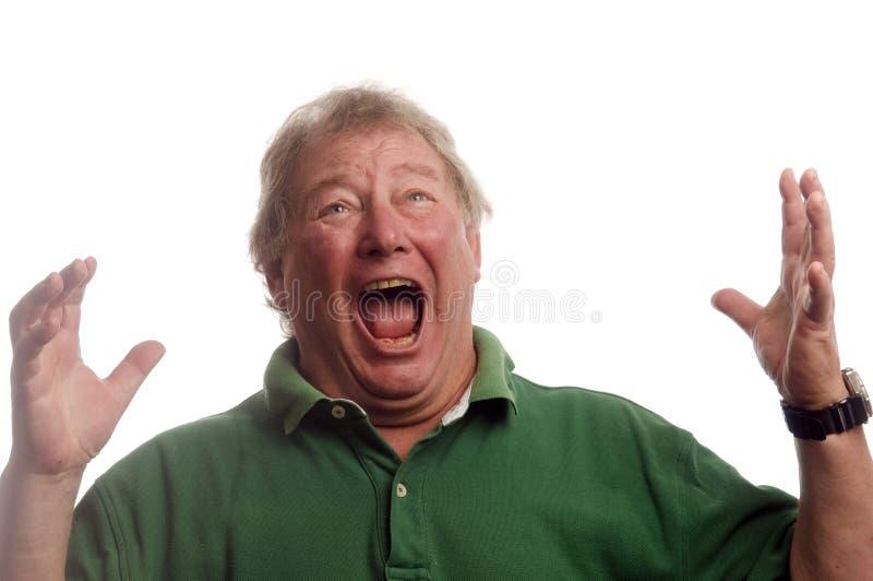 Gritar emocional do homem sênior da Idade Média em choque foto de stock