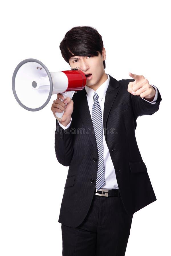 Gritar irritado do homem de negócio pelo megafone foto de stock royalty free