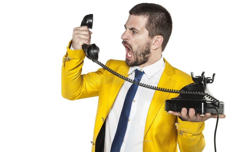 A gritaria no monofone do telefone, nervos do homem de negócios explodiu imagens de stock