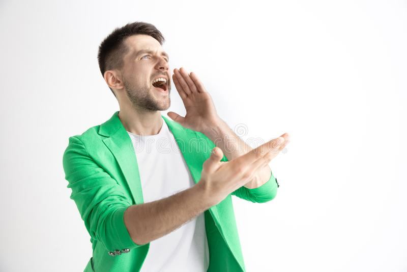 Grito casual joven del hombre grito foto de archivo