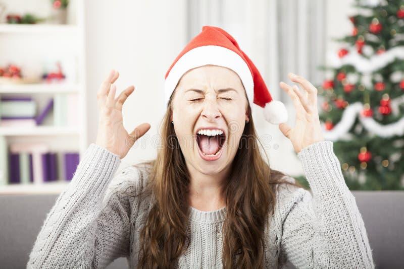 Grito da moça devido ao esforço do Natal imagem de stock royalty free