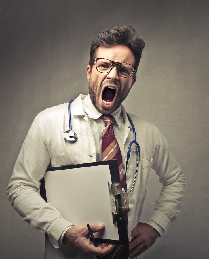 Grito del doctor fotos de archivo