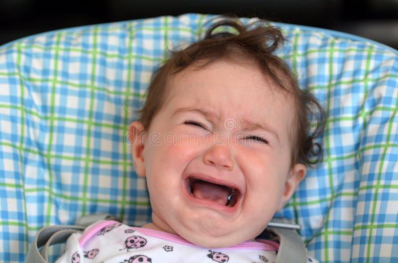 Grito e grito do bebê fotografia de stock royalty free
