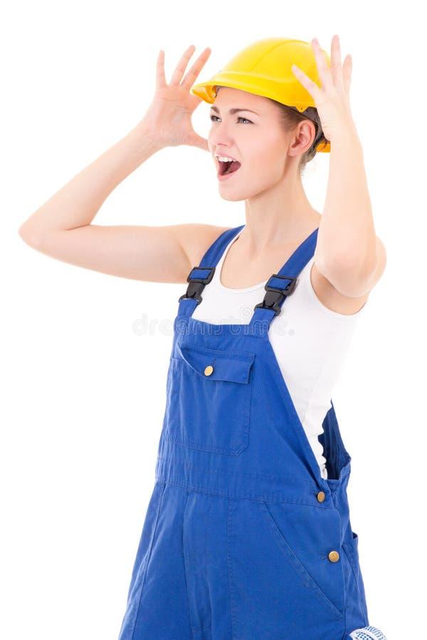 Grito nervioso del constructor de la mujer aislado en blanco fotografía de archivo libre de regalías
