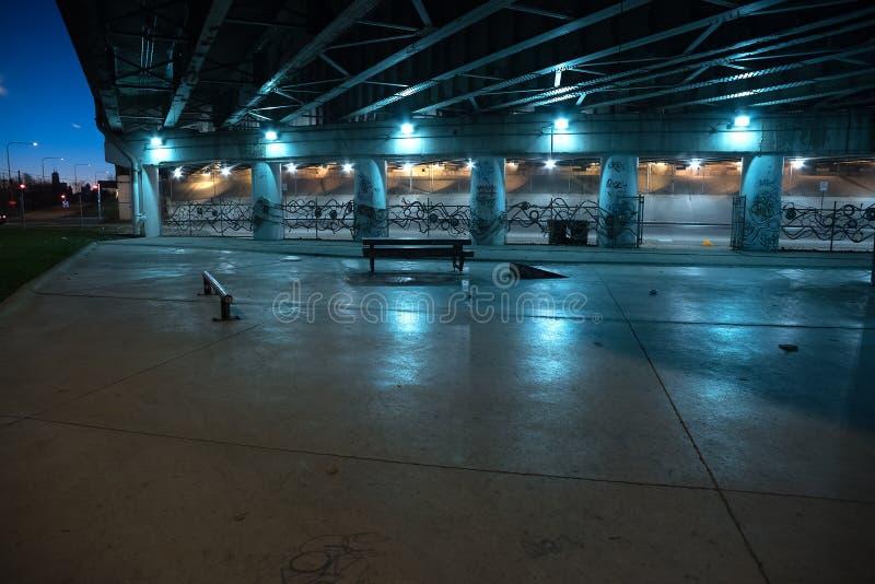 Gritty dark Chicago highway bridge underpass at night. stock photos