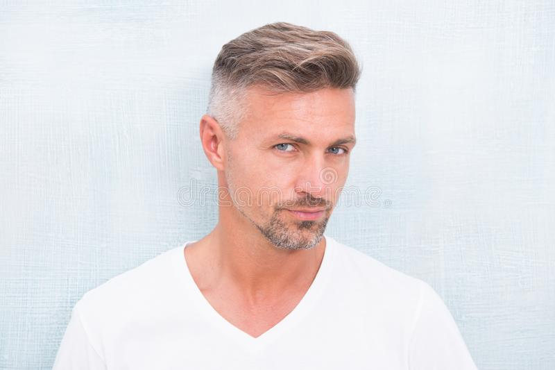 Grizzle hair suits him. Deal with gray roots. Man attractive well groomed facial hair. Barber shop concept. Barber and. Hairdresser. Man mature good looking royalty free stock image