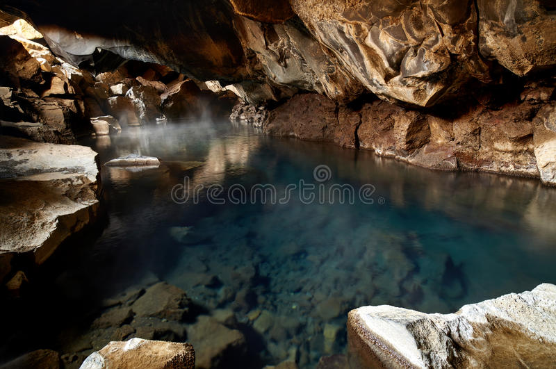 Grjotagja cave Iceland. Famous hot spring cave in Iceland grjotagja has water above 50 degrees celcius and is dangerous for swimming royalty free stock photography