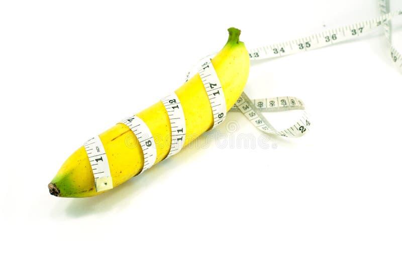 Große Banane und messendes Band lizenzfreie stockfotos