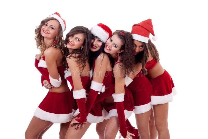 Große Gruppenweihnachtsumarmung stockbilder