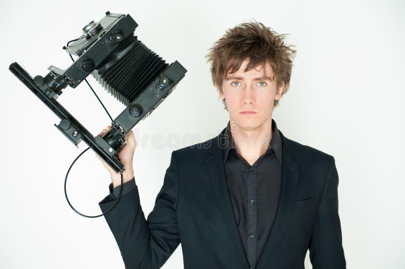 Große Kamera des Mannes stockfoto