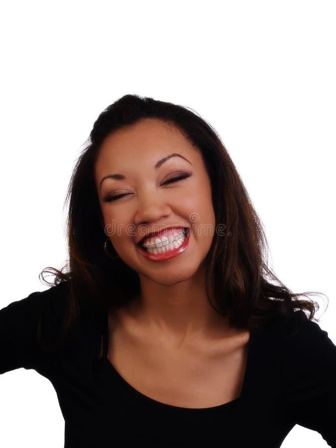 Große Lächeln-Vertretung stützt obere Zahn-schwarze Frau ab lizenzfreie stockbilder