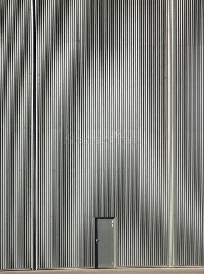 Große Tür wenig Tür lizenzfreie stockbilder