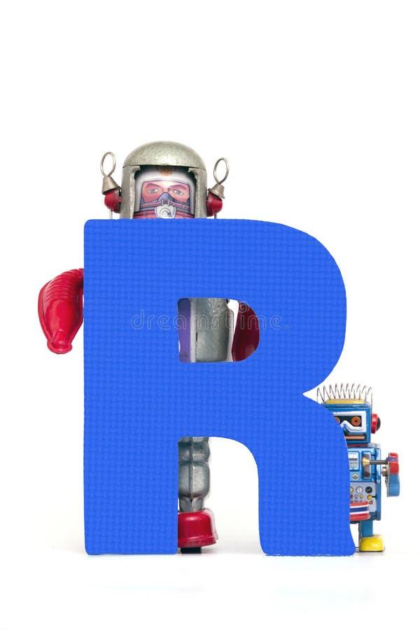 Großer Buchstabe R hielt durch Weinleseroboterspielwaren stockfotos