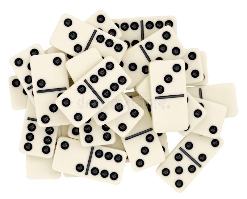 Großer Haufen von den Dominos auf weißem Hintergrund lizenzfreies stockfoto