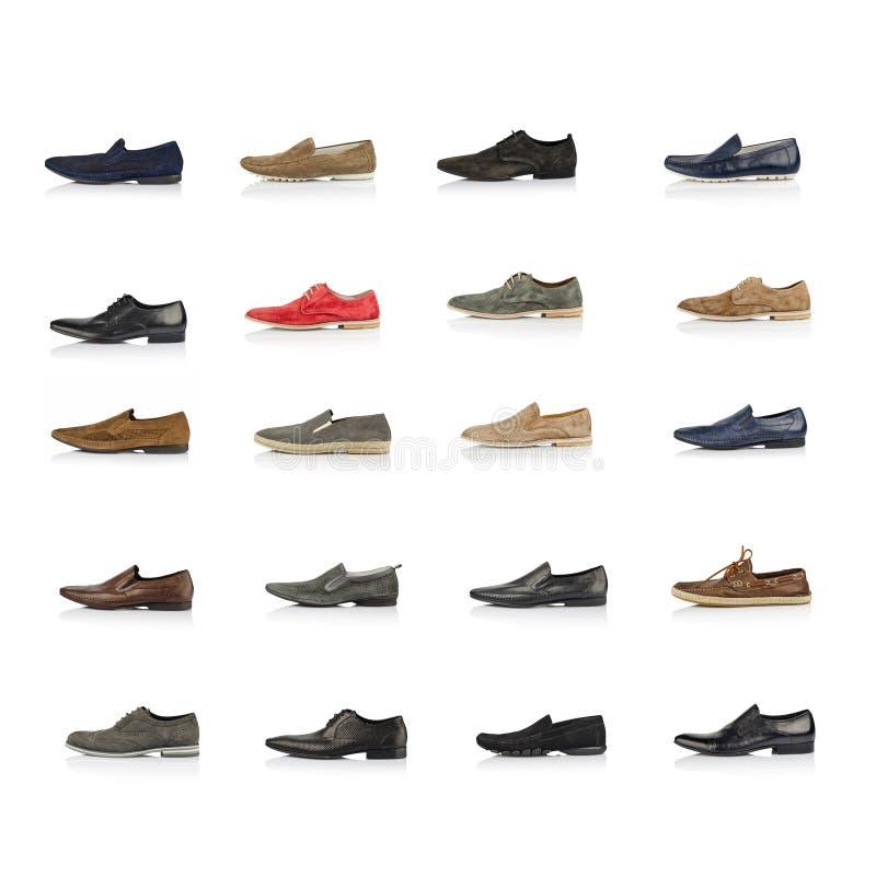Großer Satz männliche Schuhe über Weiß lizenzfreie stockbilder