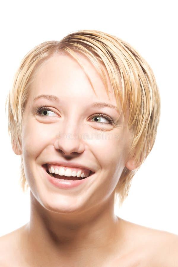 Großes Lächeln von einem blonden lizenzfreie stockfotografie