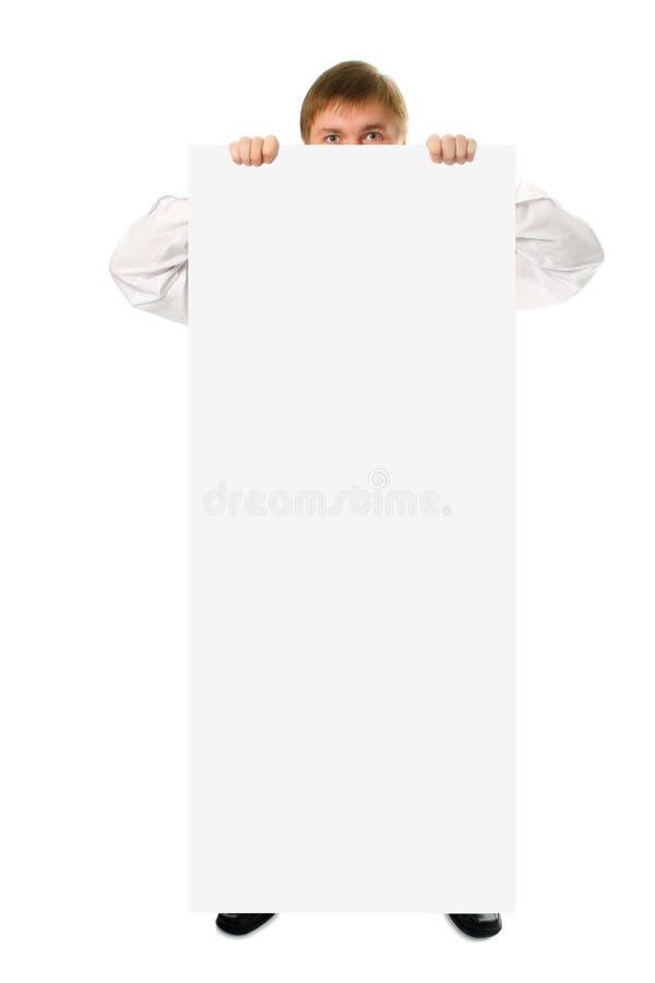 Großes weißes Plakat des Geschäftsmanneinflußes in der Hand lizenzfreie stockfotografie