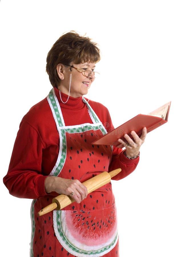 Großmutter-Kochen stockbilder