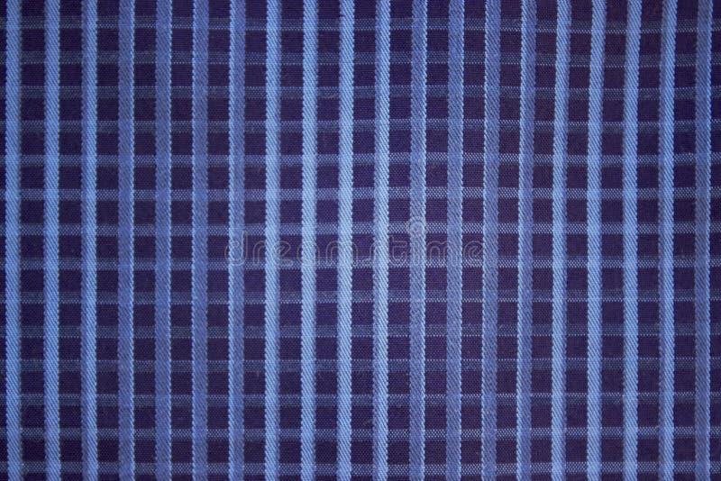 Grobe Baumwolle des blauen karierten Stoffes des Hintergrundes lizenzfreie stockfotografie