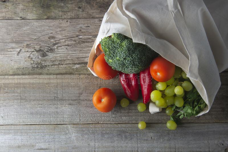 Groceries in eco bag. Eco natural bag with fruits and vegetables. Zero waste food shopping. Plastic free items. reuse, reduce, stock image
