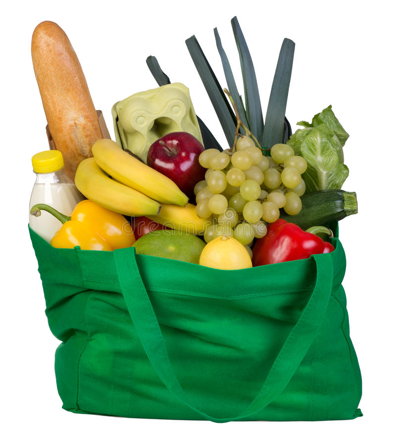 Groceries in green bag isolated on white. Background stock photos
