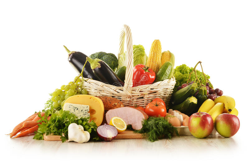 Groceries in wicker basket on kitchen table stock photos
