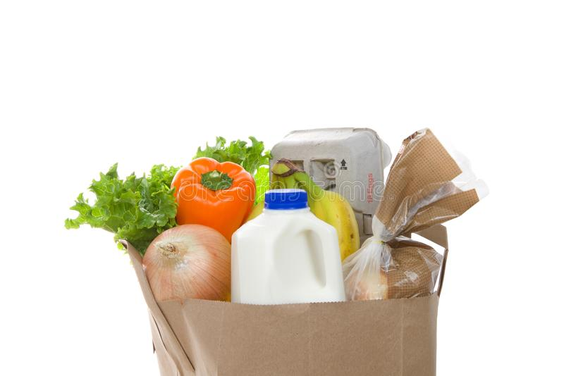Grocery bag with perishables isolated on white royalty free stock image