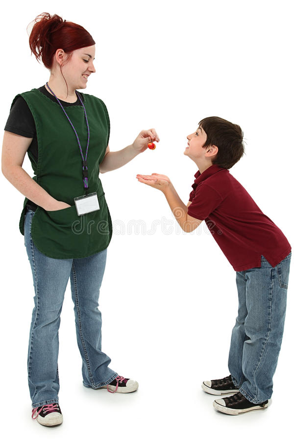 Grocery Clerk and Excited Boy. Attractive 19 year old grocery clerk woman sharing cherries with hungry excited 8 year old boy child over white. Full length over stock photos