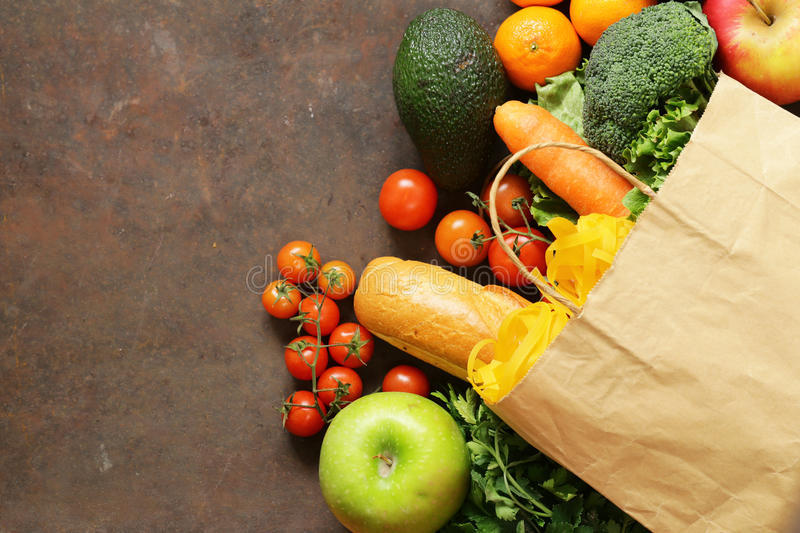 Grocery food shopping bag - vegetables, fruits, bread stock photo