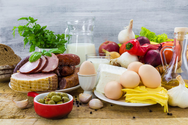 Grocery products dairy vegetables fruits meat. Composition with grocery products including dairy, vegetables, fruits and meat stock image