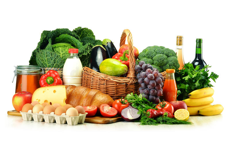 Grocery products including vegetables, fruits, dairy and drinks. Grocery products including vegetables, fruits, dairy, bread and drinks on white royalty free stock photography