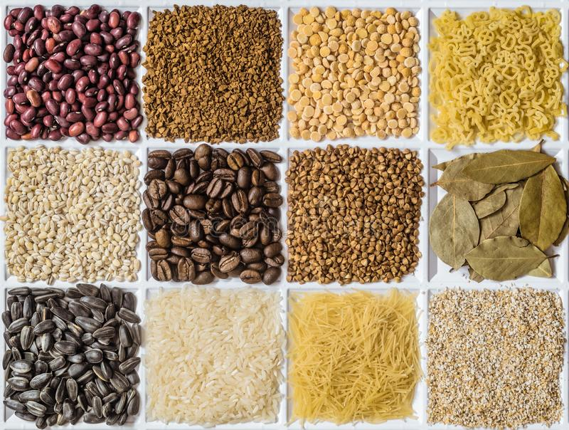 Grocery set: barley grits, vermicelli, rice, sunflower seeds, bay leafs, buckwheat, roasted coffee beans, pearl barley, figured stock image