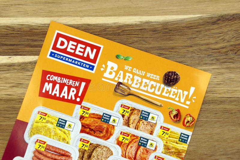 Grocery shop sale flyer of Dutch supermarket Deen. Amsterdam, the Netherlands - May 12, 2019: Grocery shop sale flyer of Dutch supermarket Deen advertising meat royalty free stock images