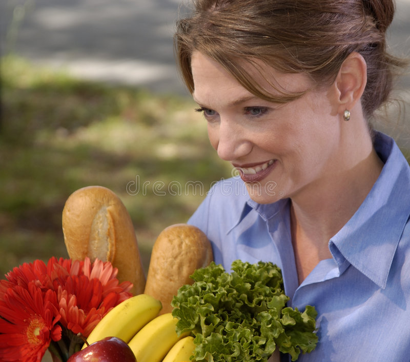 Grocery Shopping. Grocery shopper carrying fresh groceries royalty free stock photos