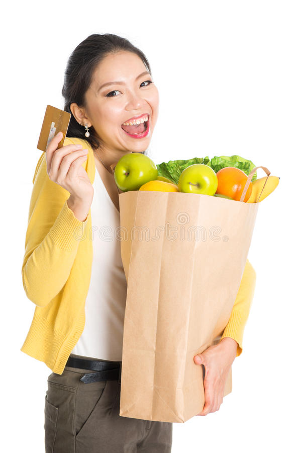 Grocery shopping female and credit card royalty free stock photography