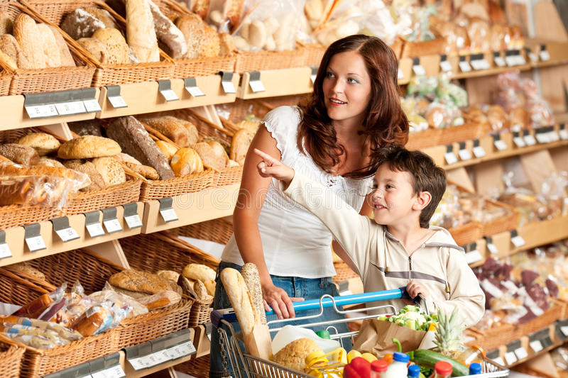 Grocery shopping store - Woman with child stock photo