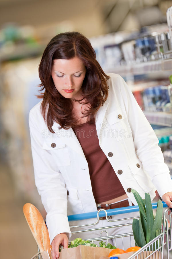 Grocery shopping store Young woman in supermarket