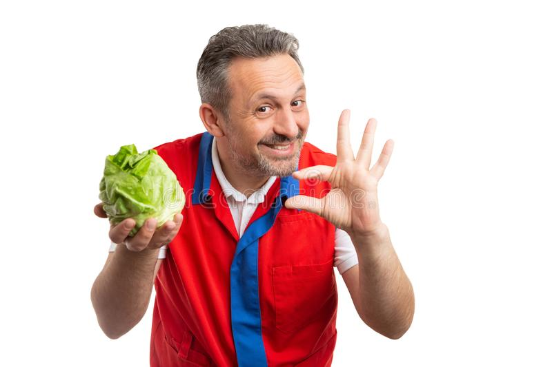 Grocery store employee advertising cabbage stock images