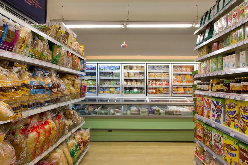 Grocery store. Products on shelves in modern grocery store shop supermarket stock photo