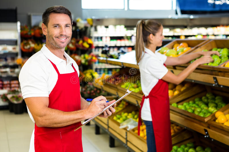 Grocery store staff with clipboard royalty free stock photos