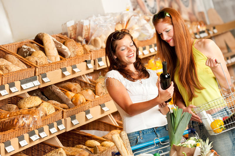 Download Grocery Store: Two Women Choosing Wine Royalty Free Stock Images - Image: 10451929