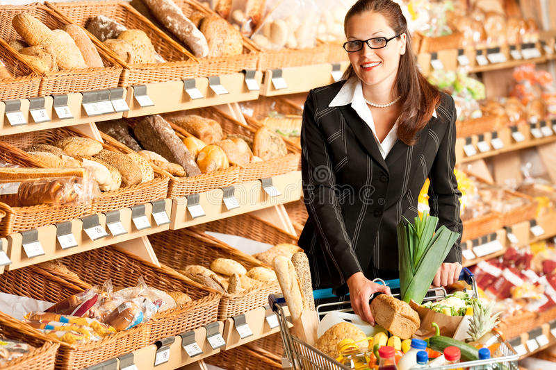 Grocery store: Young business woman royalty free stock photos