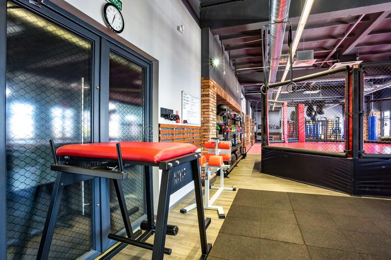 GRODNO, BELARUS - APRIL 2019: Hall of martial arts with fighting ring and punching bags in the modern Fight club royalty free stock image