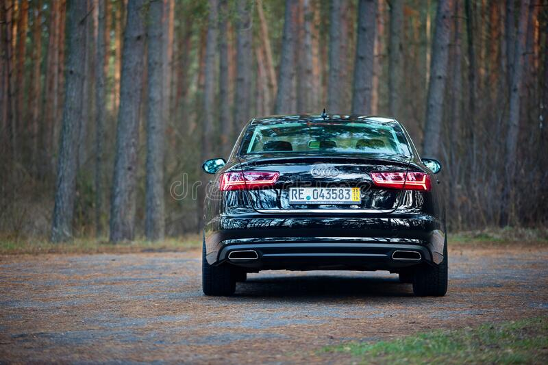 GRODNO, BELARUS - DECEMBER 2019: Audi A6 4G, C7 2.0 TDI 190 Hp 2016 facelift rear outdoors on winter road during testdrive with royalty free stock images