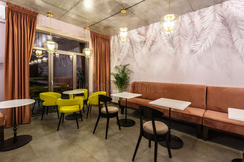 GRODNO, BELARUS - DECEMBER, 2018: inside interior in small modern pub cafe with loft design style stock images