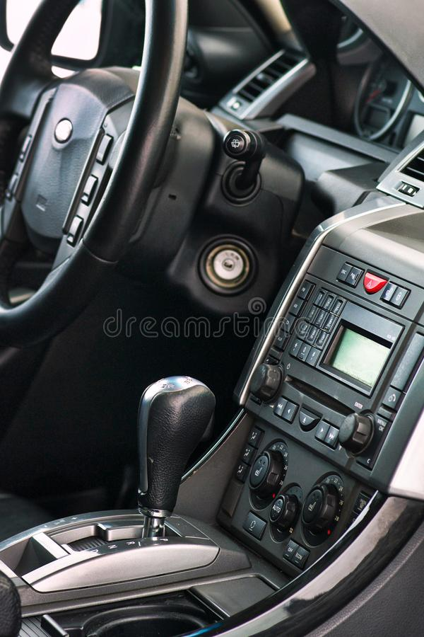 Luxury prestige car interior details. Middle console with gearbox air and multimedia controls and wheel royalty free stock images