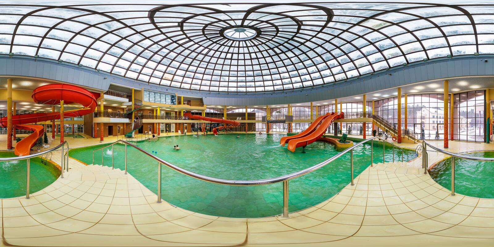 GRODNO, BELARUS - FEBRUARY 21, 2013: Panorama of interier hall swimming pool bathroom aquapark, full 360 seamless panorama in. Equirectangular spherical stock photography