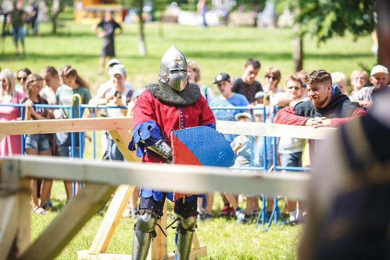 GRODNO, BELARUS - JUNE 2019: medieval jousting knight fight, in armor, helmets, chain mail with axes and swords on lists. historic. Reconstruction of ancient stock photo