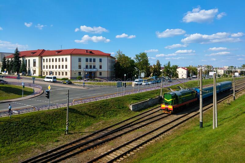 Grodno, Belarus - May 12, 2019: View of the city and railway tracks. A train royalty free stock photo